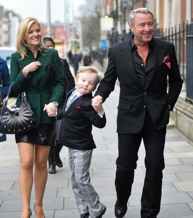 Michael Flatley with wife Niamh and son Michael Jnr on a visit to Dublin. He tries to travel with the family on business trips.