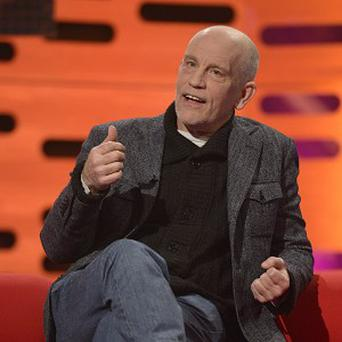 John Malkovich helped a man who had fallen and cut his neck badly in Toronto
