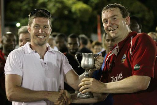 Ronan O'Gara hands the Noss Norgrove Cup to Barbarians captain Johnny Bailey in the British Virgin Islands