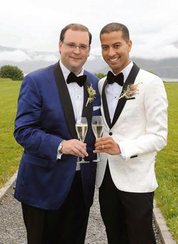 The happy couple Chris Doyle and Sean Munsanje on their wedding day in Killarney.