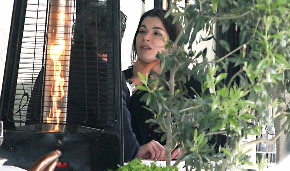 Nigella Lawson appears to be upset as husband Charles Saatchi grips her neck in Mayfair, London. Photo: Jean-Paul