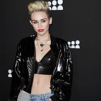Miley Cyrus was spotted going to the cinema with fiance Liam Hemsworth