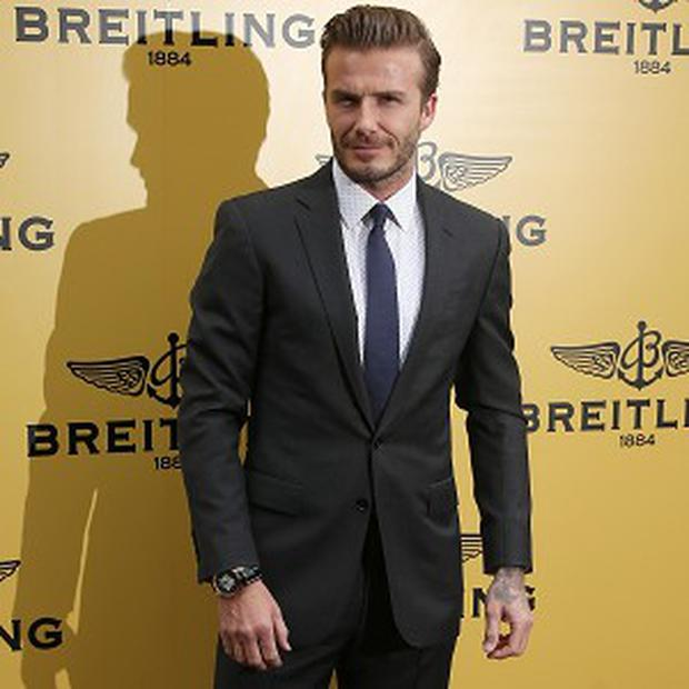 David Beckham comfortably won the 100m dads' race at his son Cruz's school sports day in London.