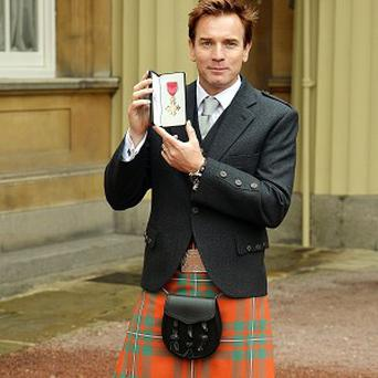 Ewan McGregor wore a kilt to collect his OBE medal from the Prince of Wales