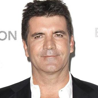 Simon Cowell is in talks about his X Factor deal