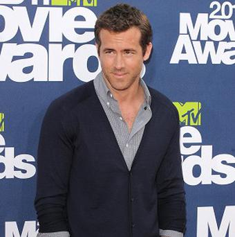 Ryan Reynolds can see himself with a big family