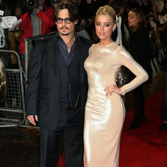 Amber Heard has been spending time with Johnny Depp and his children