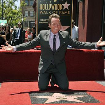 Bryan Cranston joked he would receive a 'bruise' every time someone walked on his Walk of Fame star