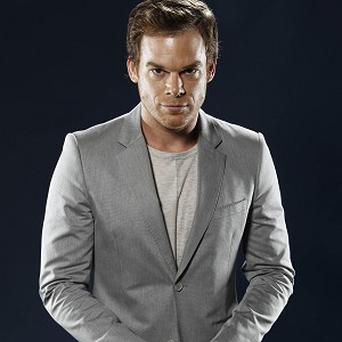 Michael C Hall plays a serial killer in Dexter