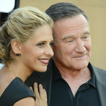 Sarah Michelle Gellar wants co-star Robin Williams to adopt her