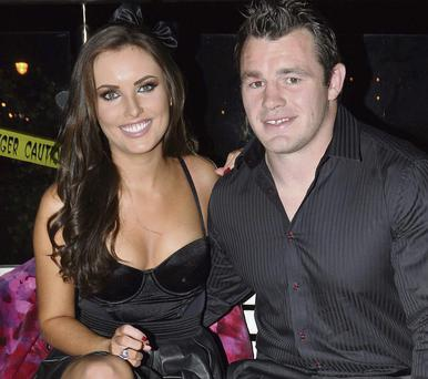Holly Carpenter, left, with boyfriend and rugby star Cian Healy
