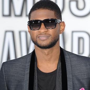 Usher's five-year-old son is in hospital after nearly drowning in a pool