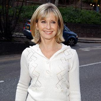 A man was found dead inside a Florida home owned by singer Olivia Newton-John and her husband