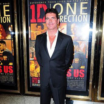 Simon Cowell arriving for the World Premiere of One Direction: This Is Us, at the Empire Leicester Square, London