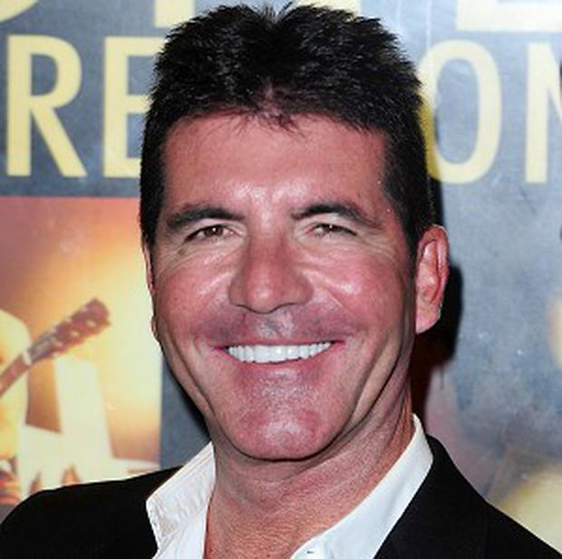 Simon Cowell reportedly wants to name his baby after his late father
