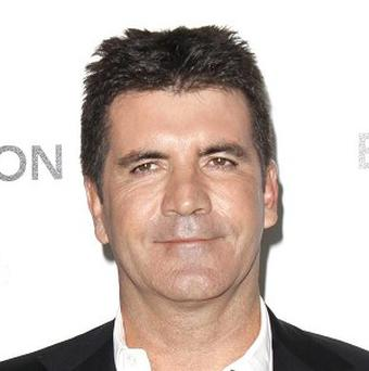 Simon Cowell dined with Louis Walsh and Lauren Silverman