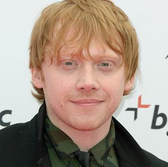 Rupert Grint wants to put a slide on his flat