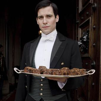 Rob James-Collier plays footman Thomas in Downton Abbey
