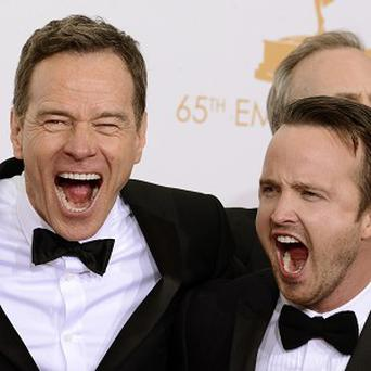 Bryan Cranston and and Aaron Paul celebrate Breaking Bad's Emmy win
