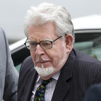 Rolf Harris faces nine counts of indecent assault and four counts of making indecent images