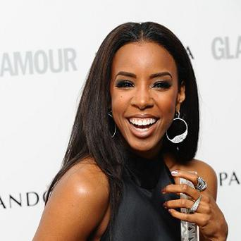 Kelly Rowland says she's not ready for children just yet