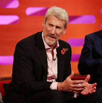 "Jeremy Paxman has paid tribute to fellow broadcaster David Dimbleby's tattoo by signing off Newsnight with the ""Good Nite"" inked across on his fingers."
