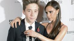 Victoria Beckham and her son Brooklyn at the Harper's Bazaar Women of the Year Awards at Claridge's Hotel in London