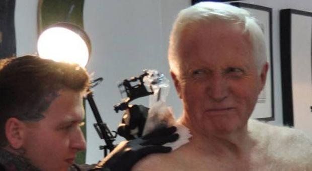 David Dimbleby (75) getting his tatoo