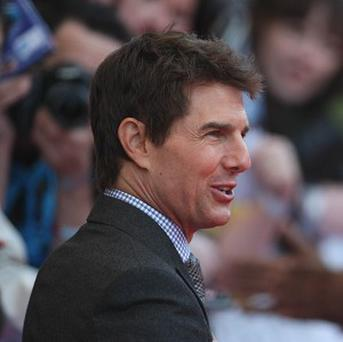 Tom Cruise and the tabloids had reached a confidential settlement in a defamation case filed by the Mission: Impossible star