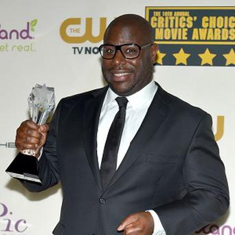 Steve McQueen with the award for best picture for 12 Years A Slave. (/Invision/AP)