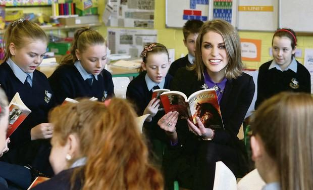 Amy Huberman reads from 'War Horse' with pupils from City Quay National School, Dublin at the launch of the Student Theatre Awards. Photocall