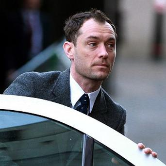 Jude Law arrives at the Old Bailey in London to take the witness box in the phone hacking trial