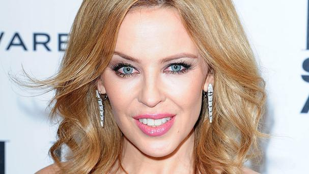 Kylie Minogue said putting her emotions into song was like therapy