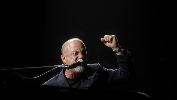 Billy Joel was joined on stage by AC/DC lead singer Brian Johnson at a concert in New York