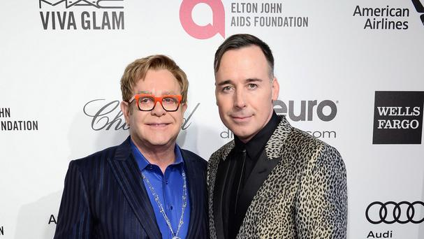 Sir Elton John and David Furnish will have a quiet wedding in May