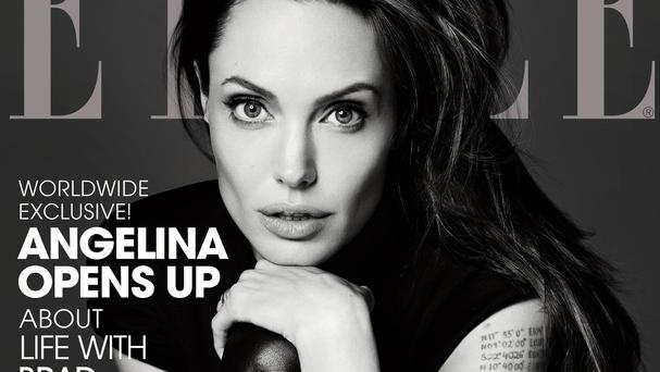 Angelina Jolie graces the front cover of Elle's June issue