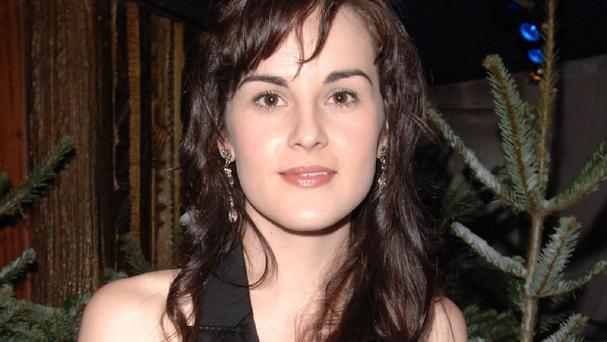 Michelle Dockery has said she likes to look back at how young the Downton Abbey cast were in the first series