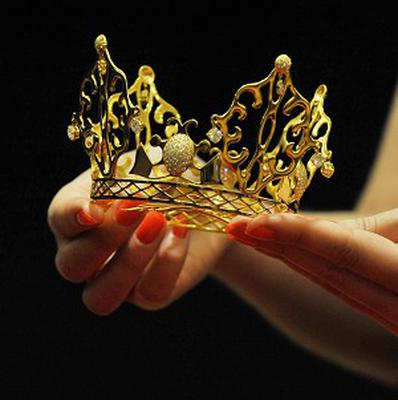 The gold and diamond East of Paris tiara was worn by Victoria Beckham