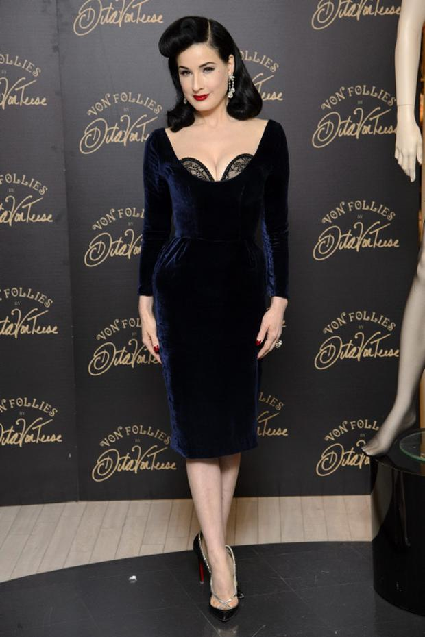 LONDON, ENGLAND - NOVEMBER 28: Dita Von Teese attends a photocall to launch her new lingerie range at Debenhams on November 28, 2012 in London, England. (Photo by Ben Pruchnie/Getty Images)