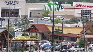 Law enforcement officers investigate the car park of the Twin Peaks restaurant in (AP/Waco Tribune-Herald)