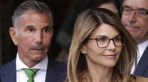 Lori Loughlin, front, and her husband, clothing designer Mossimo Giannullii (Steven Senne/AP))
