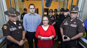 Rowan County Clerk Kim Davis makes a statement to the media at the front door of the Rowan County Judicial Centre. (AP)