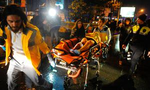 Paramedics take an injured woman from the nightclub after the attack Photo: AFP/Getty Images
