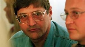 Eugene de Kock, head of a covert police unit that tortured and killed dozens of people, pictured in 1998 (AP)