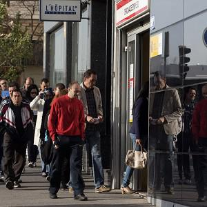 People enter an office to register for job placement in Madrid as Spanish unemployment reached a record high (AP)