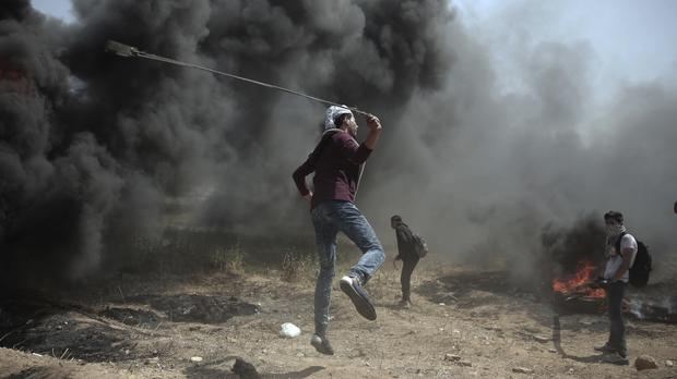 A campaign of mass protests is under way in Gaza (Khalil Hamra/AP)
