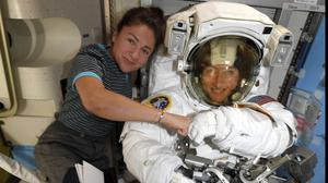 Astronauts Christina Koch, right, and, Jessica Meir pose for a photo on the International Space Station (Nasa/AP)