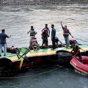 Rescuers look for survivors after a bus plunged into the Beas River near Kullu, India (AP)