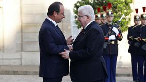 French President Francois Hollande, left, talks with Iraqi counterpart Fouad Massoum ahead of a conference in Paris (AP)
