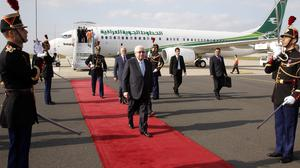 Iraq president Fouad Massoum, centre, followed by Iraq foreign minister Ibrahim Al-Jaafari, left, arrive with Iraqi officials in Paris (AP)